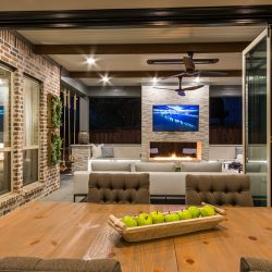 Outdoor living area integrated into home by Compass Outdoor Design