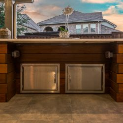 Outdoor countertops with additional storage space below installed by Compass Outdoor Design