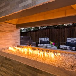 Gas outdoor fireplace in Dallas, TX by Compass Outdoor Design