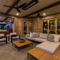 Luxurious patio design by Compass Outdoor Design with added patio furniture.