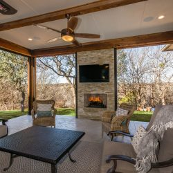 Outdoor living space in Dallas with accomodating patio furniture and a quality outdoor fireplace designed by Compass Outdoor Design