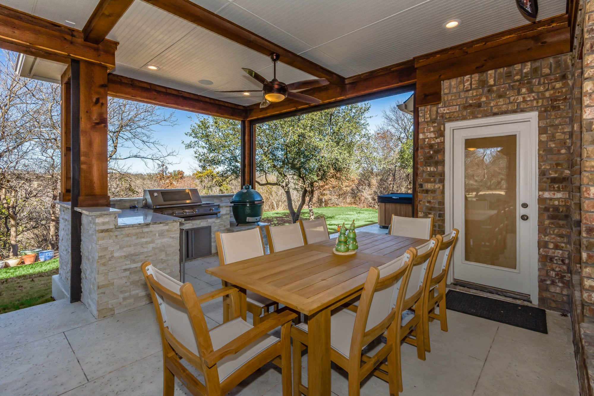 Outdoor kitchen and dining area created by the patio designers at Compass Outdoor Design