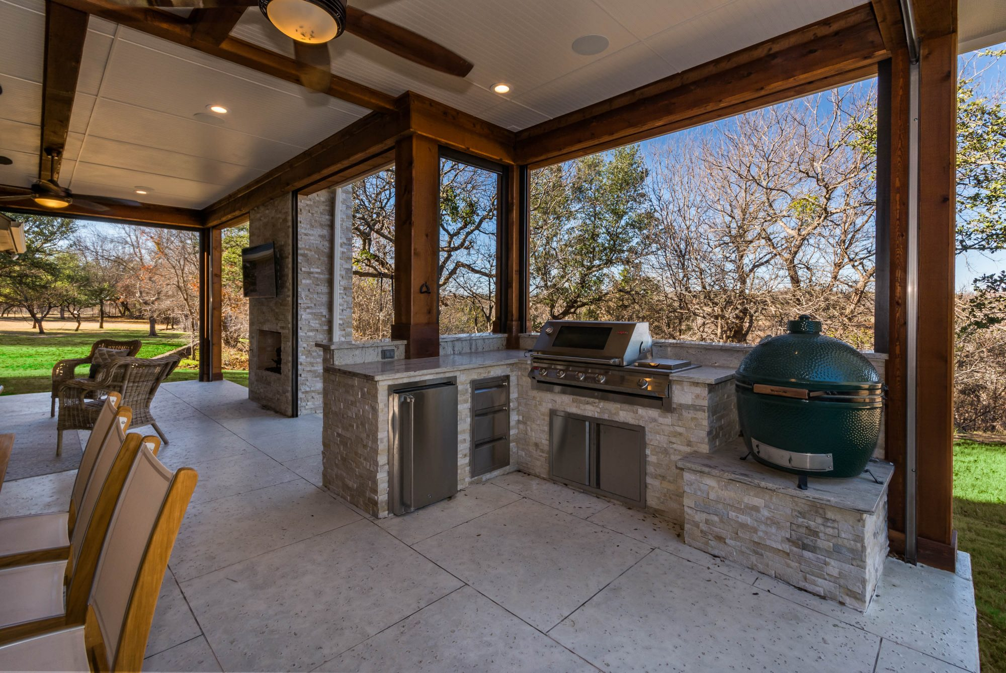 Small outdoor kitchen area within an outdoor living space in Dallas built by Compass Outdoor Design