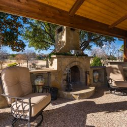 Wood-burning outdoor fireplace designed and built by Compass Outdoor Design!