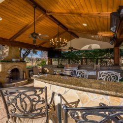 Luxurious outdoor living space complete with an pavillion, an outdoor kitchen, patio fireplace, dining area and more! Contact Compass Outdoor Design to begin designing your outdoor living space.