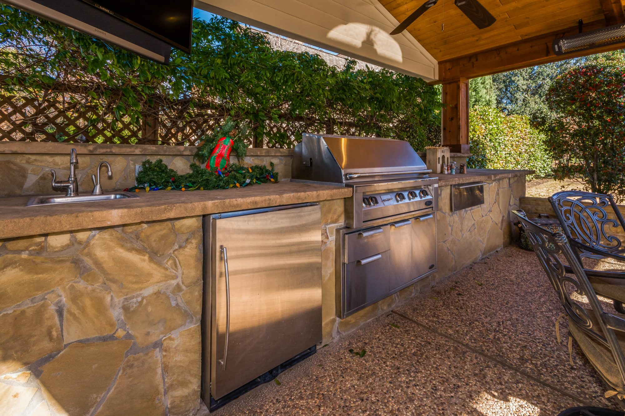 Fully-functional outdoor kitchen in Dallas designed and built by Compass Outdoor Design!