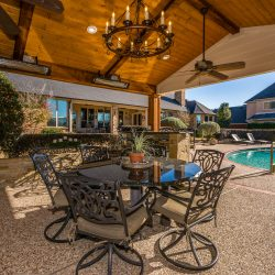 Outdoor living space in Dallas next to a swimming pool.