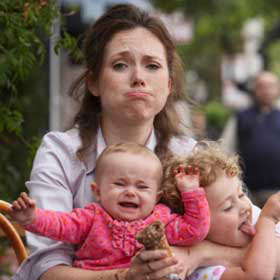 overwhelmed-mom-holding-babies