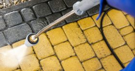 Pressure washer cleaning a tiled floor