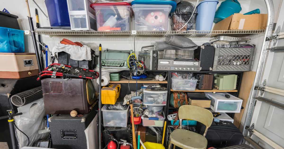 A messy garage in need of junk removal services.
