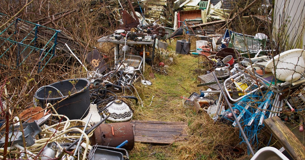 Scrap metal iron junk garbage in a backyard