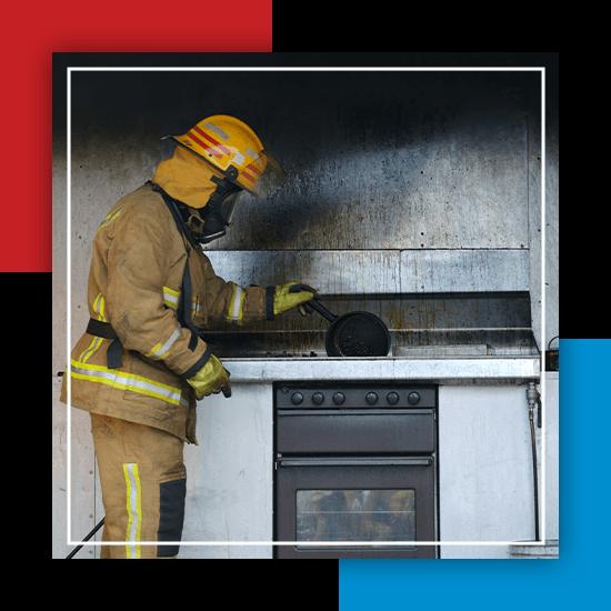 An image of a fireman inside of a fire damaged kitchen