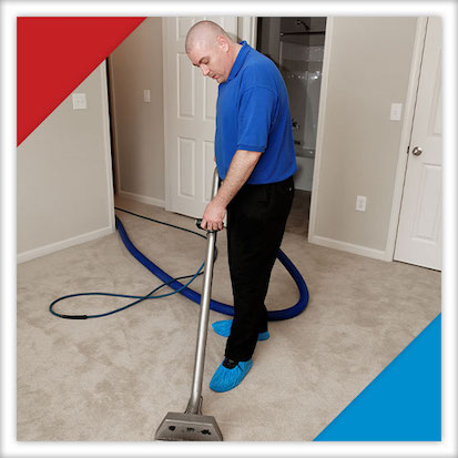 Image of someone extracting water from a carpet