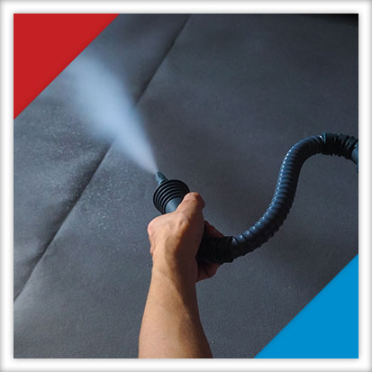 Image of someone using a steam cleaner for carpet restoration