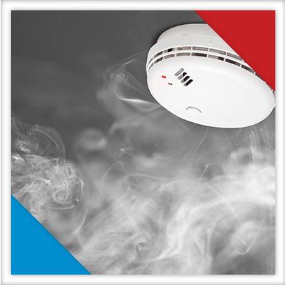 Image of smoke setting off a smoke alarm