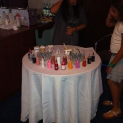 Guests creating custom nail polish at Creative Games designed event