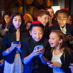 Texting children competing for bar mitzvah activities
