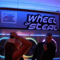 Event guests playing game show entertainment Wheel of Steel