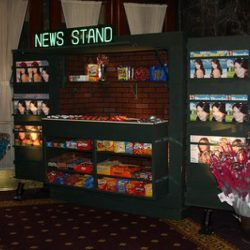 Manhattan Style News Stand concessions with wide variety of candy and food options for event guests from Creative Games