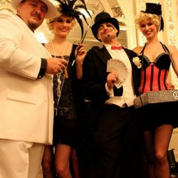 Elaborate costumes and scenery used to create a mobster themed corporate event design
