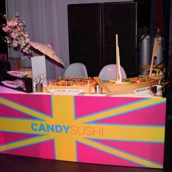 Custom corporate event with food catering from Creative Games featuring the candy sushi booth