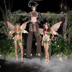Midsummer's night themed corporate event with beautiful, elaborate costuming and decor