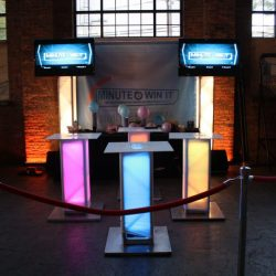 Minute to win it party entertainment game show with a custom themed set-up