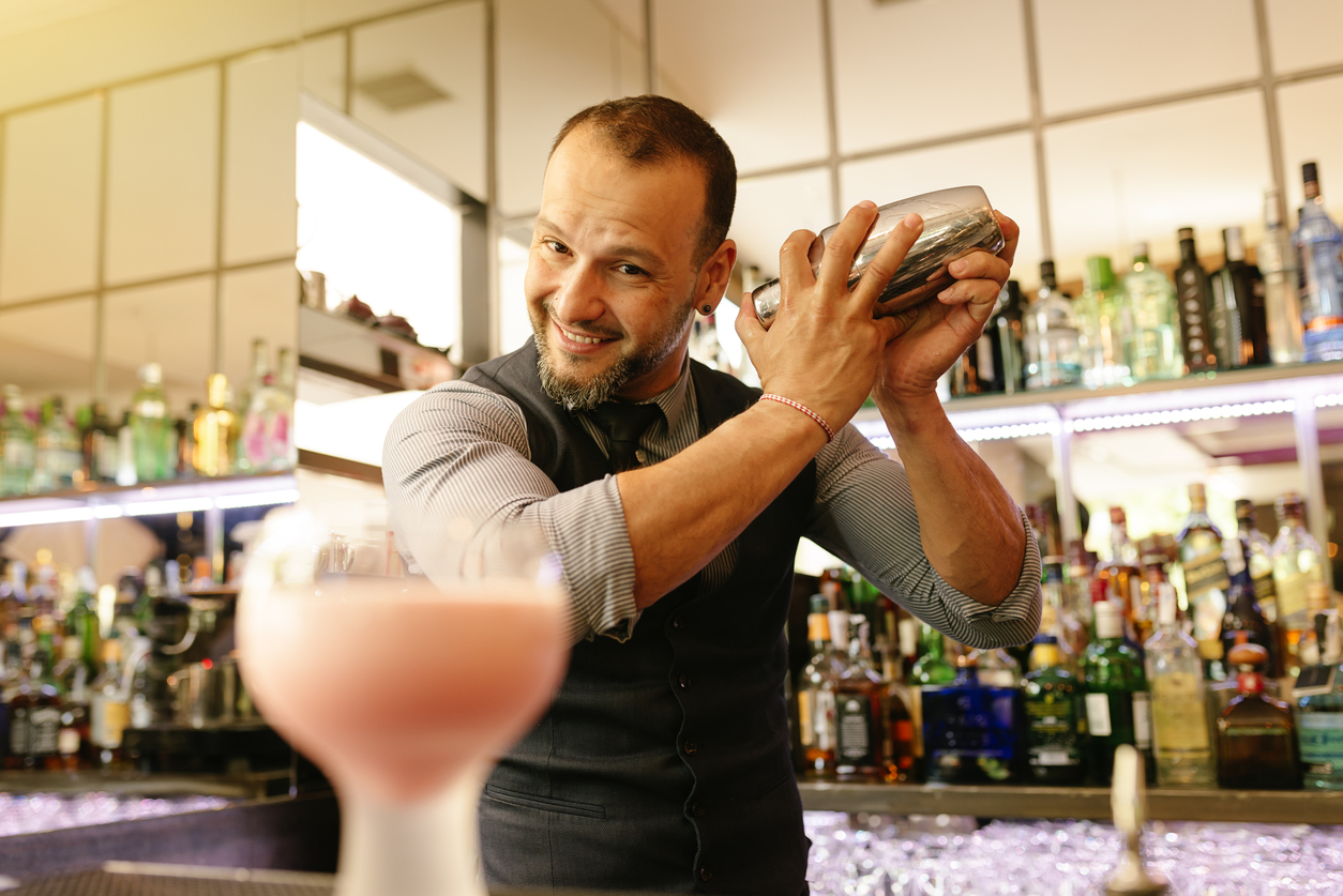 bartender happily making coctail