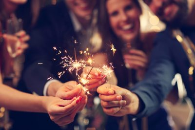 group of friends celebrating and having fun with sparklers