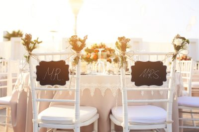 White Mr and Mrs chairs at wedding reception table