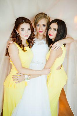Bride-hugging-2-bridesmaids-wearing-yellow-dresses