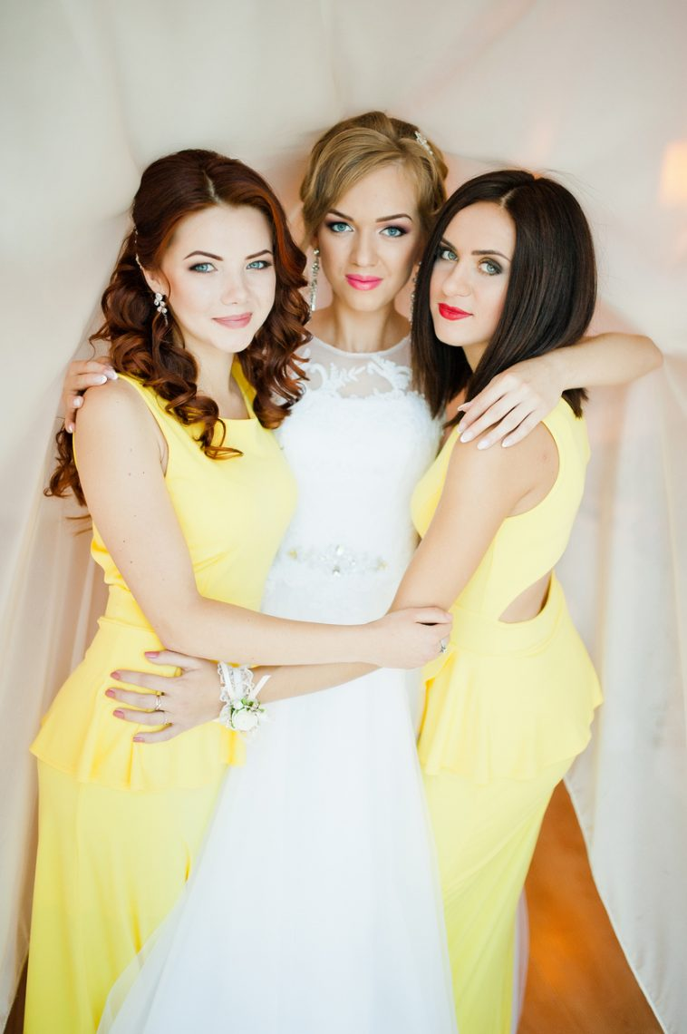 Bride-hugging-2-bridesmaids-wearing-yellow-dresses