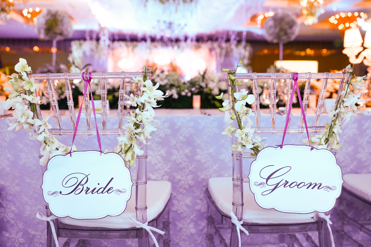 back-view-of-bride-and-groom-chairs-at-wedding