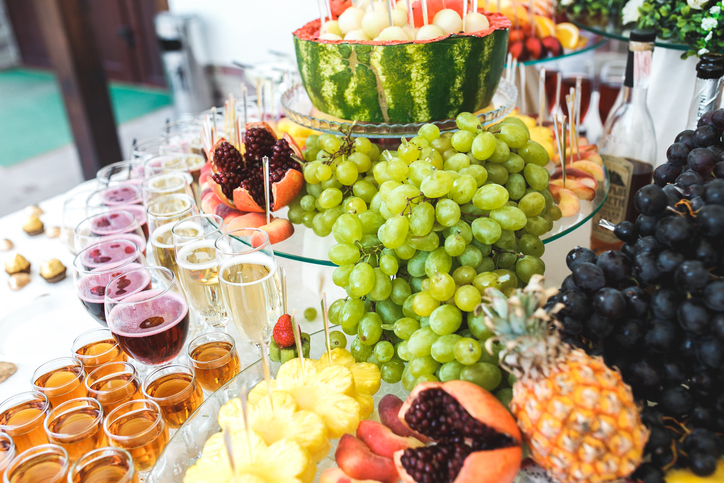 Rich buffet with drinks and beautiful scenery of fruit and sweets at an all-inclusive wedding