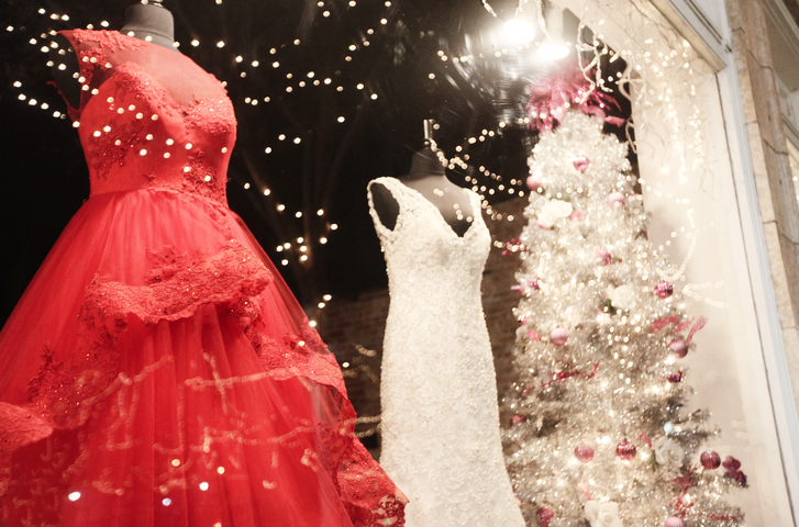 beautiful winter wedding dresses in display window.