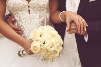 bride-and-groom-holding-hands
