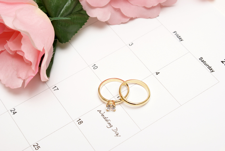 A note on a calendar sets a reminder for the wedding day.Wedding plan