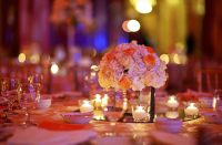 A wedding table fully decorated in a ballroom.