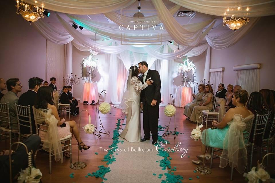 bride and groom kiss at Crystal Ballroom wedding