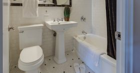 image of bathroom with black and white tiled floor