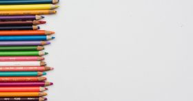 An image of a series of colored pencils on a white background.