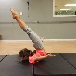 Child Performing Acro Stretch
