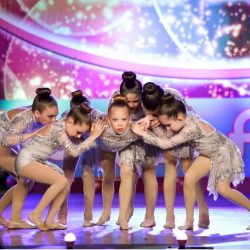 Group of Children Performing in Lyrical Dance Competition