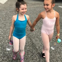 Two Dance Students Holding Hands