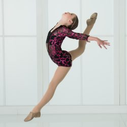 Young Ballerina Performing a Grand Jeté