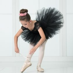 Young Ballet Dancer Strapping Her Ballet Shoes