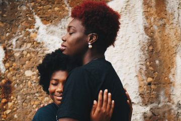Image of mother hugging child