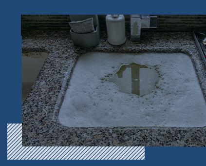 A clogged kitchen sink