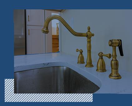A modern, gold kitchen sink fixture