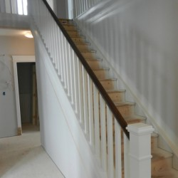 Finished stair handrail made of wood.